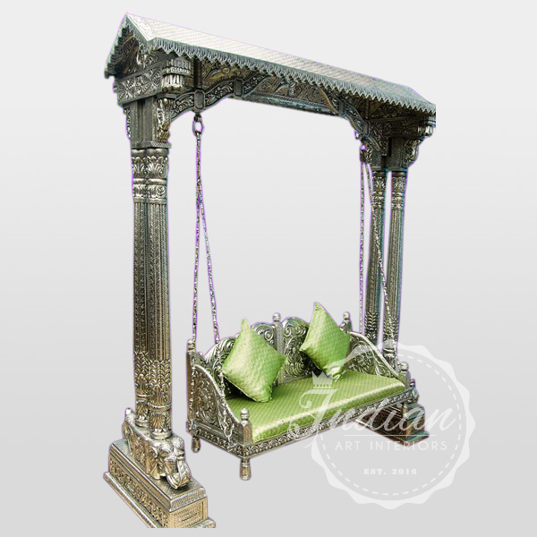 carved antique silver swing