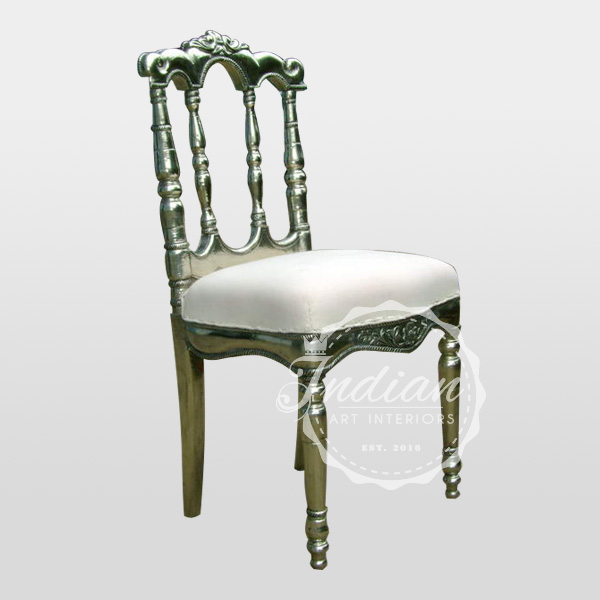 carved white metal chair