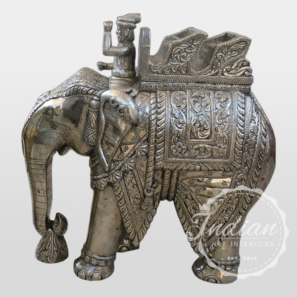 white metal carved elephant-statue