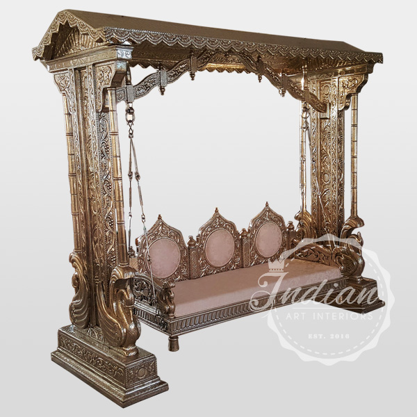 white metal carved porch swing