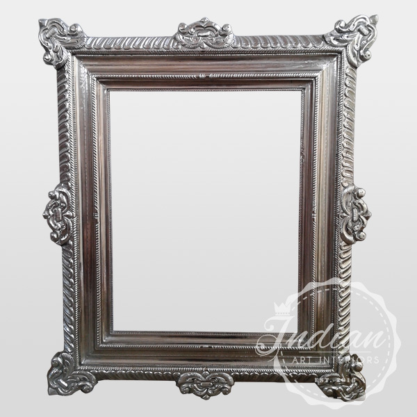 white metal carved mirror frame