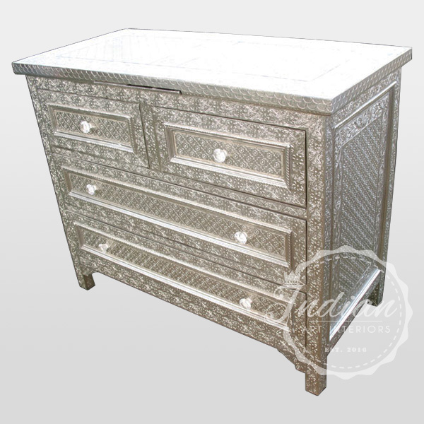 white metal embossed commode